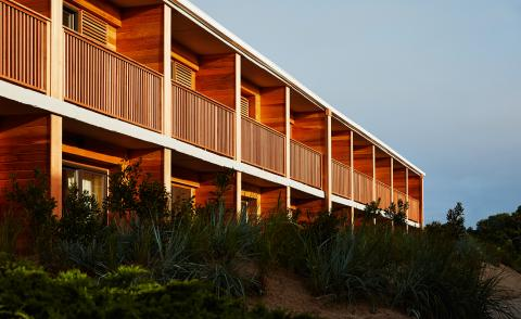 The wooden façade of the Marram Hotel, Montauk, featuring square balconies facing the sea