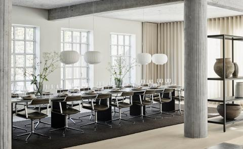 vipp supper club table setting in converted warehouse in Copenhagen