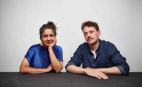 Portrait of Superflux co-founders Anab Jain and Jon Adern sitting behind a table