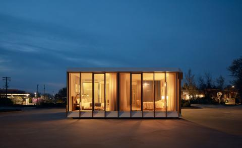 Mitek is a modular housing model by Danny Forster & Architecture, seen here in a night shot