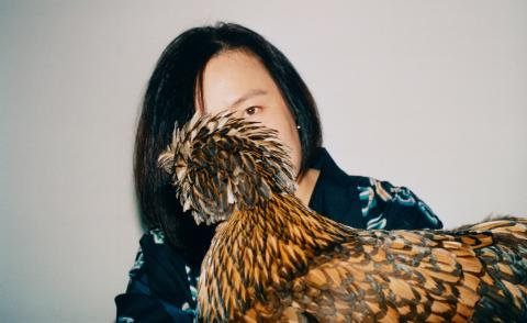 Chinese artist Cao Fei photographed with her chicken