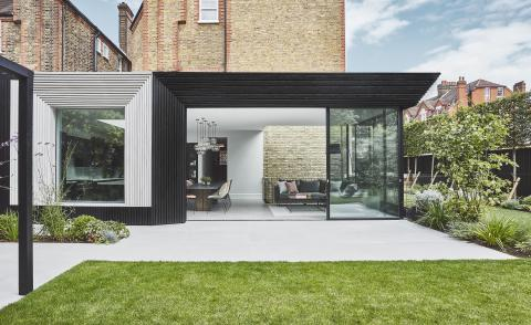 Nightingale Triangle house extension with cascading wood cladding