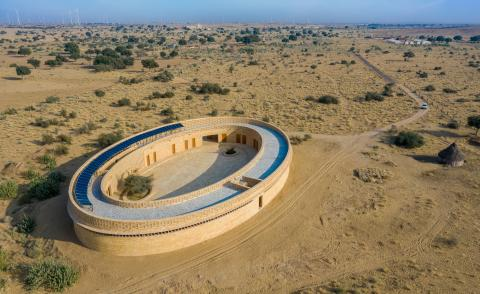Sustainable girl's school in India is shaped like an oval from above