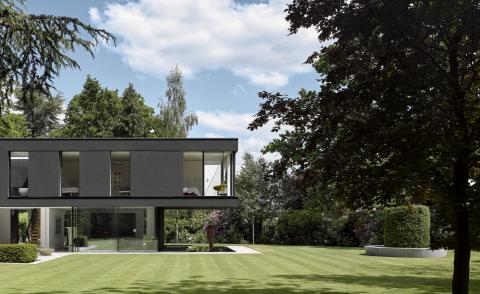 Winter House's external view within greenery