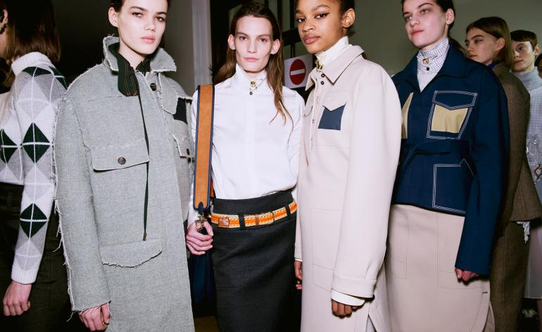 Carven A/W 2018: Models wear deconstructed outerwear with exposed stitching