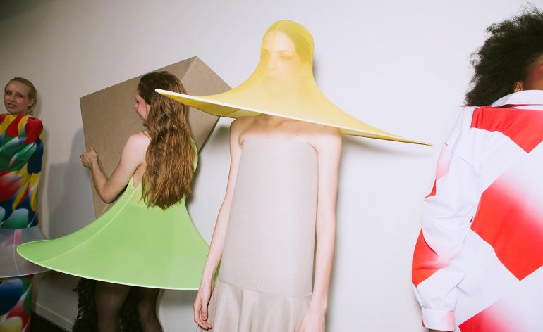 Models wear asymmetrical dresses, gauzy skirts and sunhats with sturdy lampshade-like hems