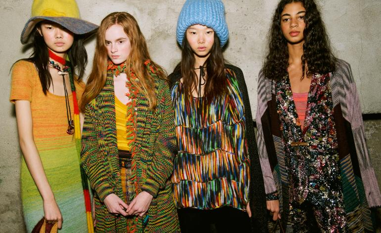 Models wear a range of multicoloured knitwear, from cardigans, T-shirt dresses and jumpers
