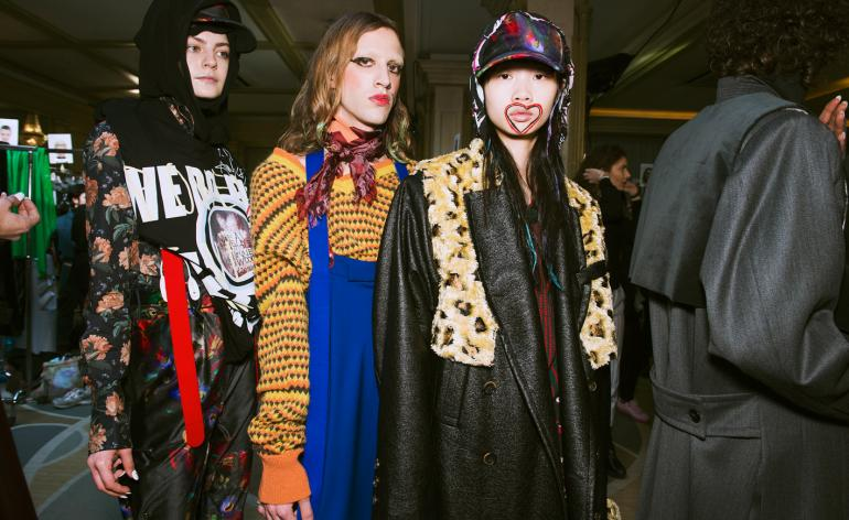 Models are seen wearing logo printed t-shirts, floral jackets, animal-print outerwear and knitted jumpers