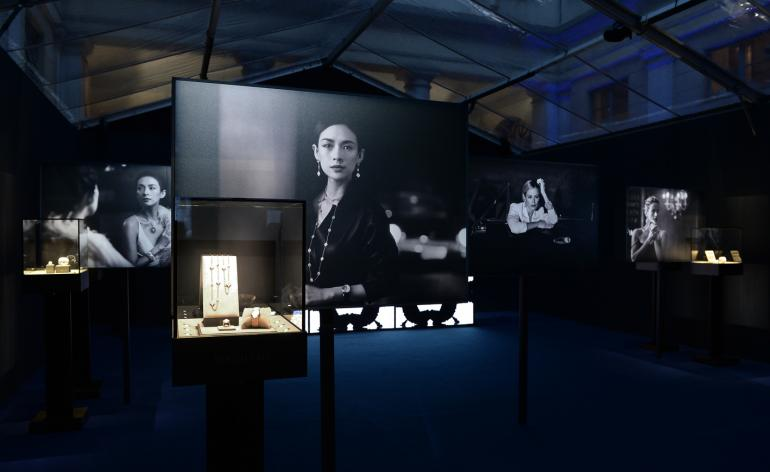Exhibition space displaying latest campaign image say Peter Lindbergh