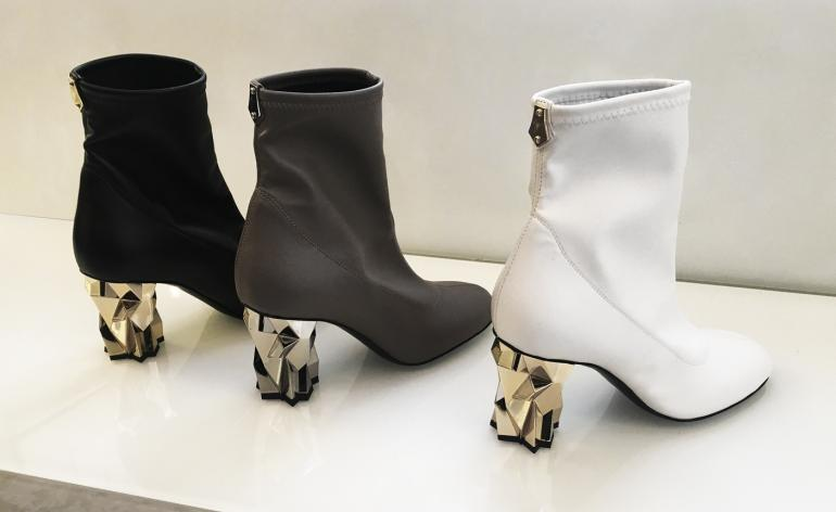 Black, white and grey high sock boots with architectural heel
