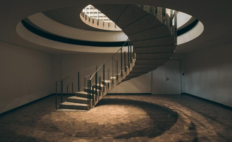 A spiralling concrete staircase at the CBR HQ, conceived and selected by Constantin Brodzki