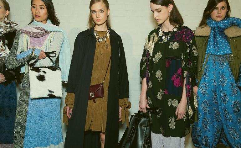 Models wear floral and silk dresses and autumnal shades