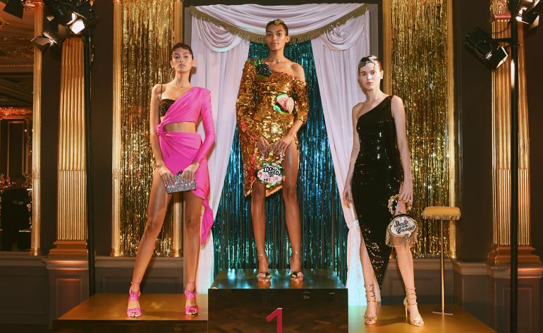 Models wear glitzy ballroom dresses in hot pink, gold and black