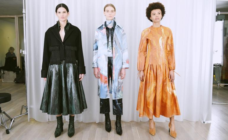 Models wear ruffled skirts, long line jackets and exotic dresses