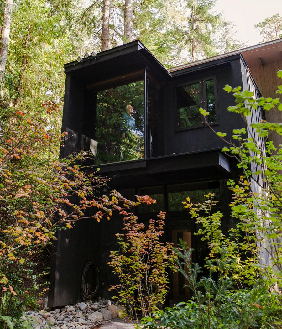 Architect Jim Olson at an expansive window at his holiday home in Washington state