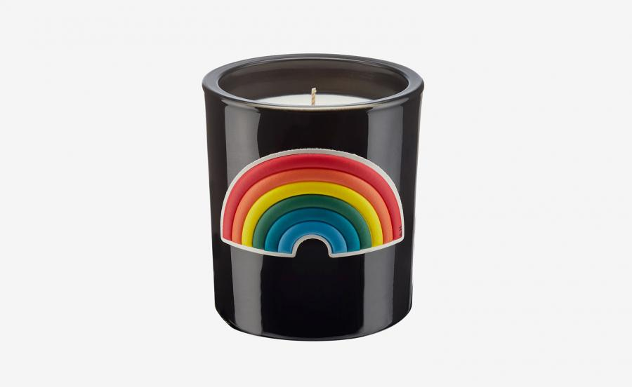 Washing powder candle, with a rainbow on it, by Anya Hindmarch
