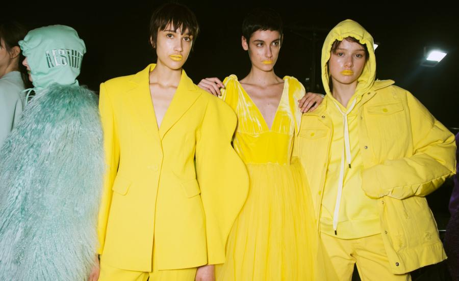 Models wear yellow suit, dress, hoodie, jacket and mint fur coat and hoodie