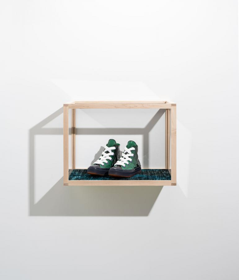 JW Anderson x Converse sneakers sit in a display case