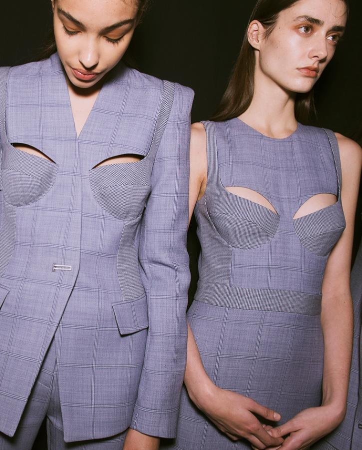 Backstage sees models wearing cropped sweaters and pastel-coloured cut-out suits