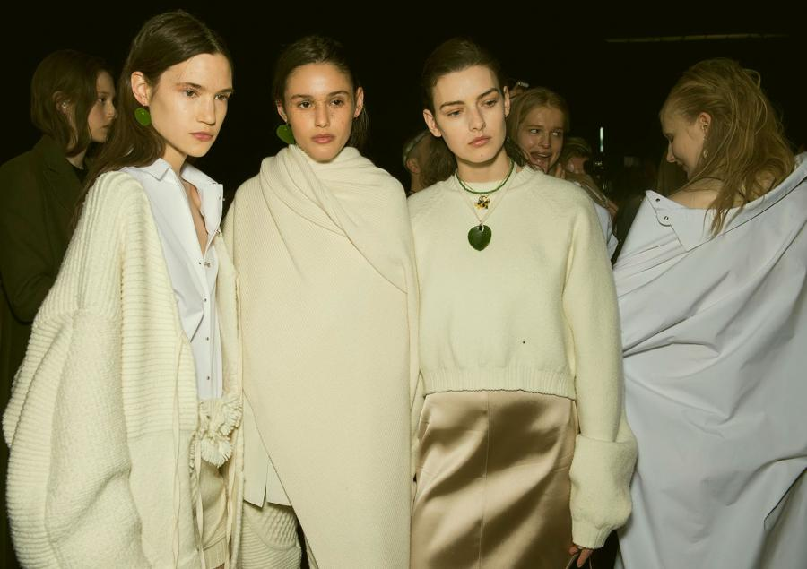 Models wear cream knitwear and shimmering silks