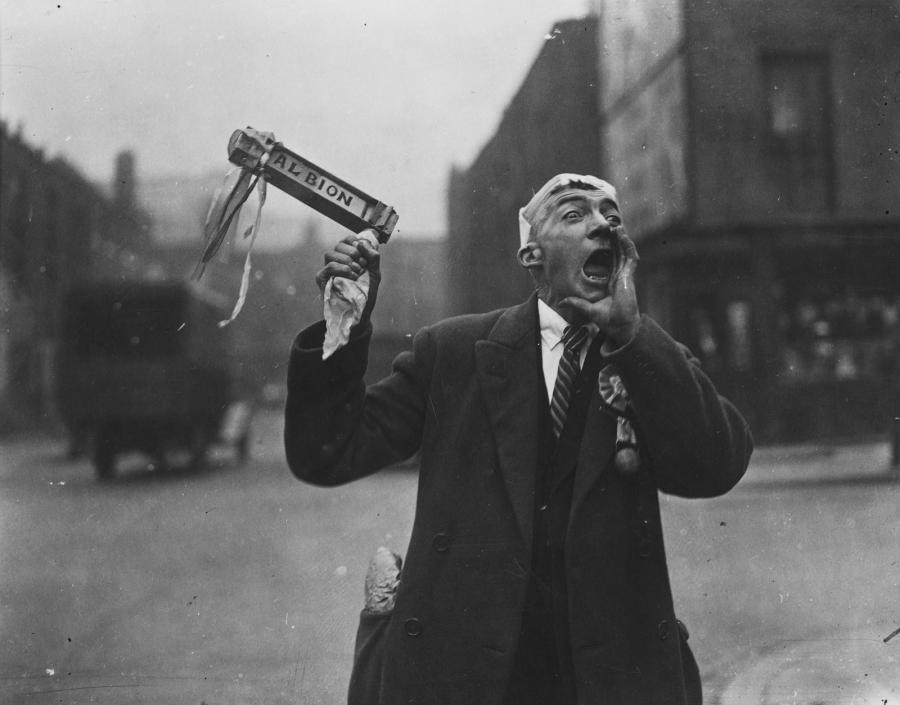 A West Bromwich Albion FC fan cheers as he makes his way to Wembley Stadium for the FA Cup final in 1935