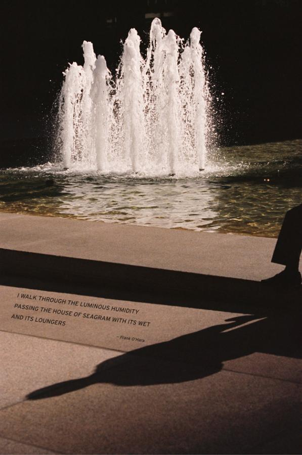 A fountain with the shadow of a passerby in front