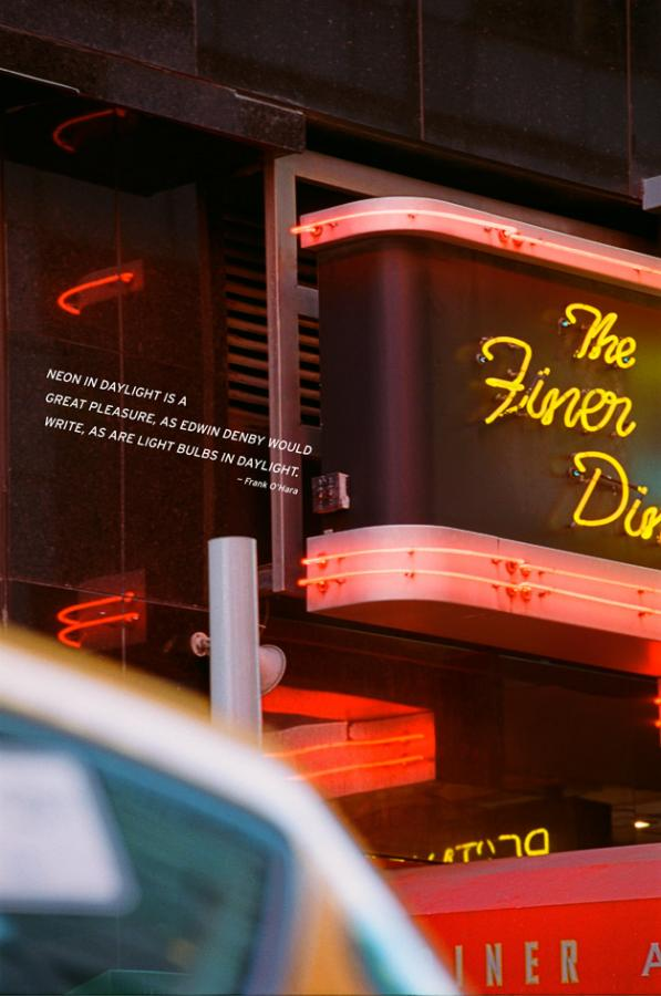 Neon lights of a New York diner during daytime