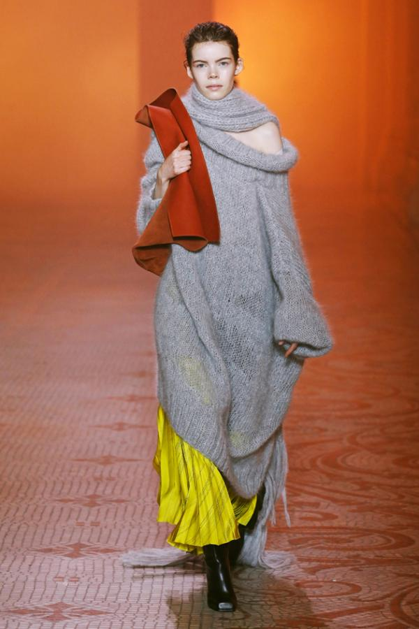 Poiret: model wears an overused grey cashmere dress with yellow trousers