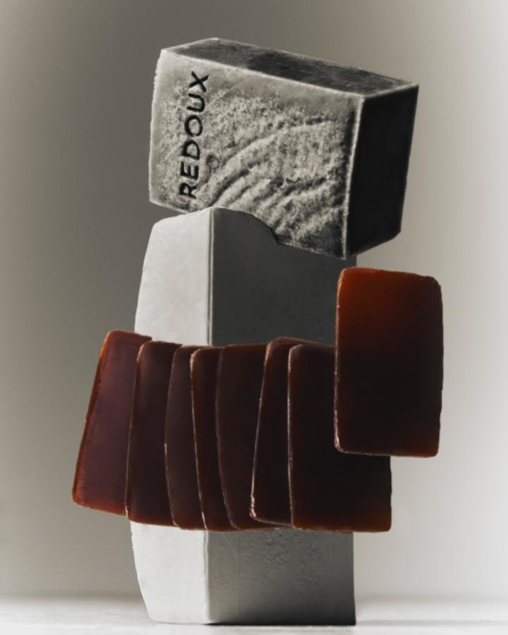 grey redoux soap with red soap flakes