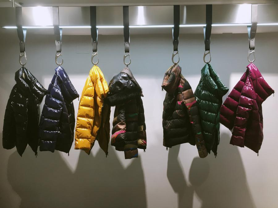 Puffer jackets in different colours hung at the presentation