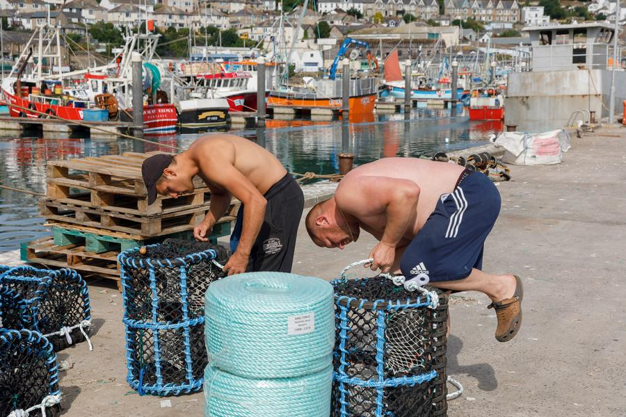 Preparing lobster pots, Newlyn Harbour, Cornwall, England, 2018, by Martin Parr