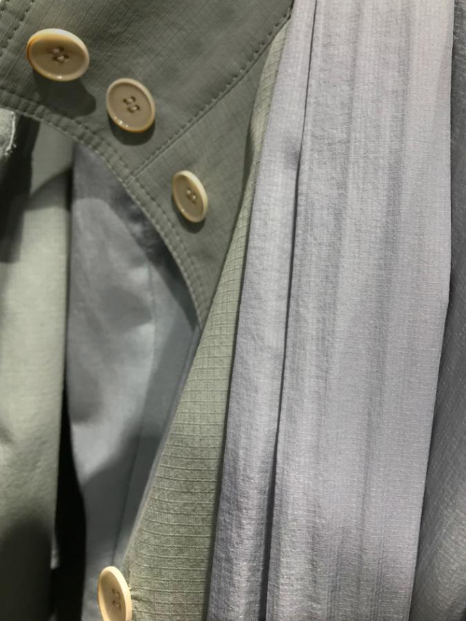 Khaki coat with ivory buttons