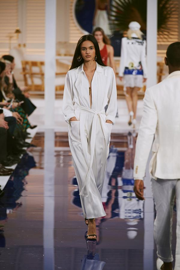 Model wears a beach holiday-inspired white robe