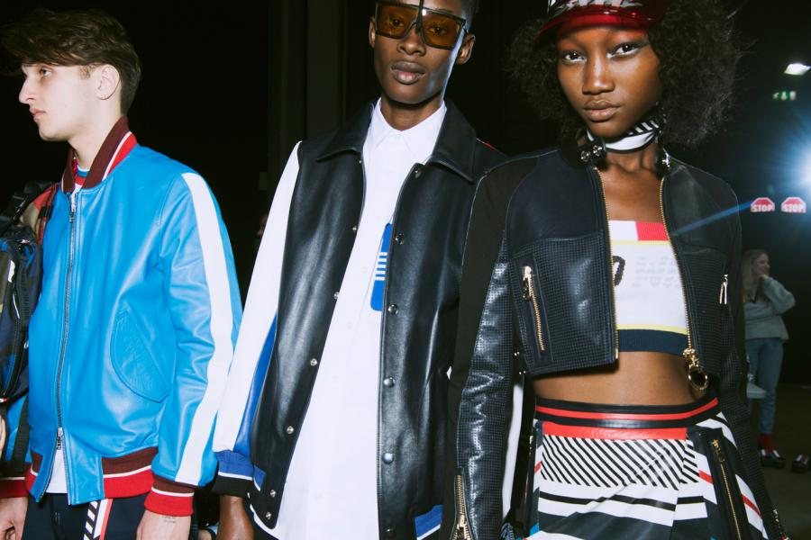 Models wearing cropped biker jackets and colourful leather skirt