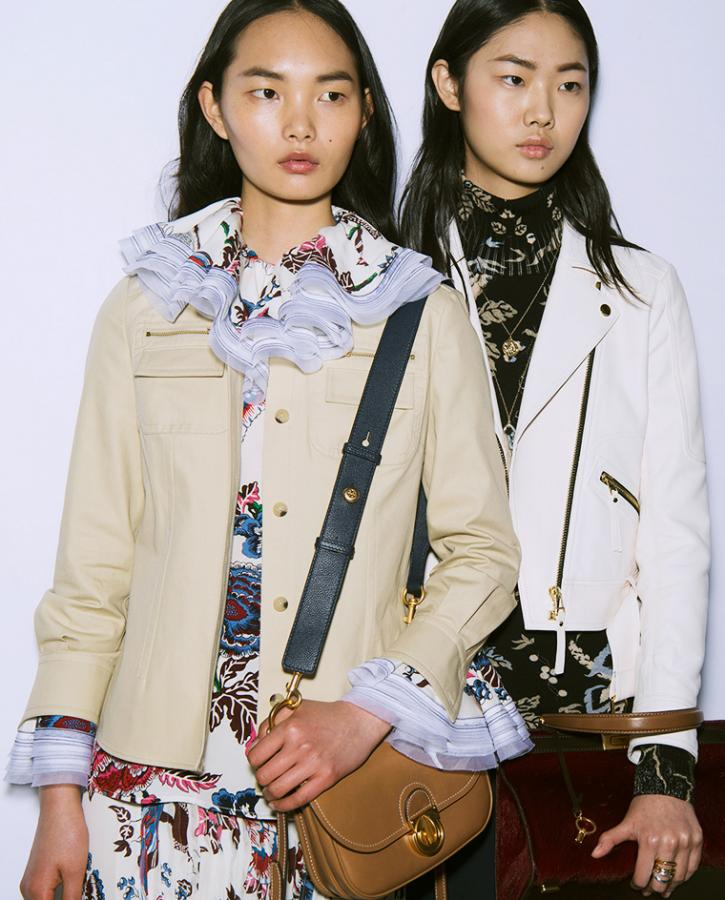 Dressed in exaggerated ruffled shirts, models are seen wearing pale biker jackets paired with leather accessories