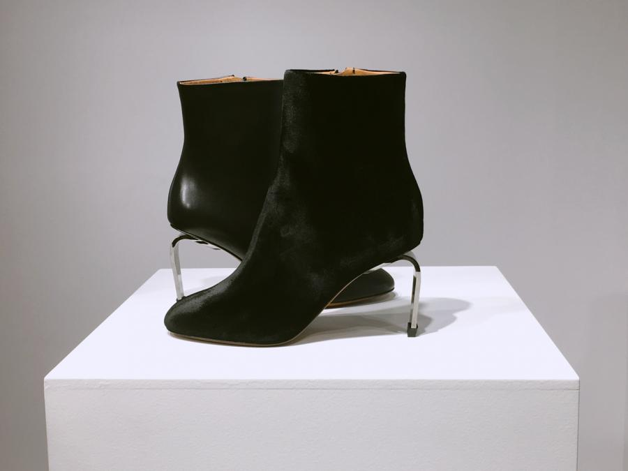 Robert Clergerie A/W 2018 shows black boots with a metal heel