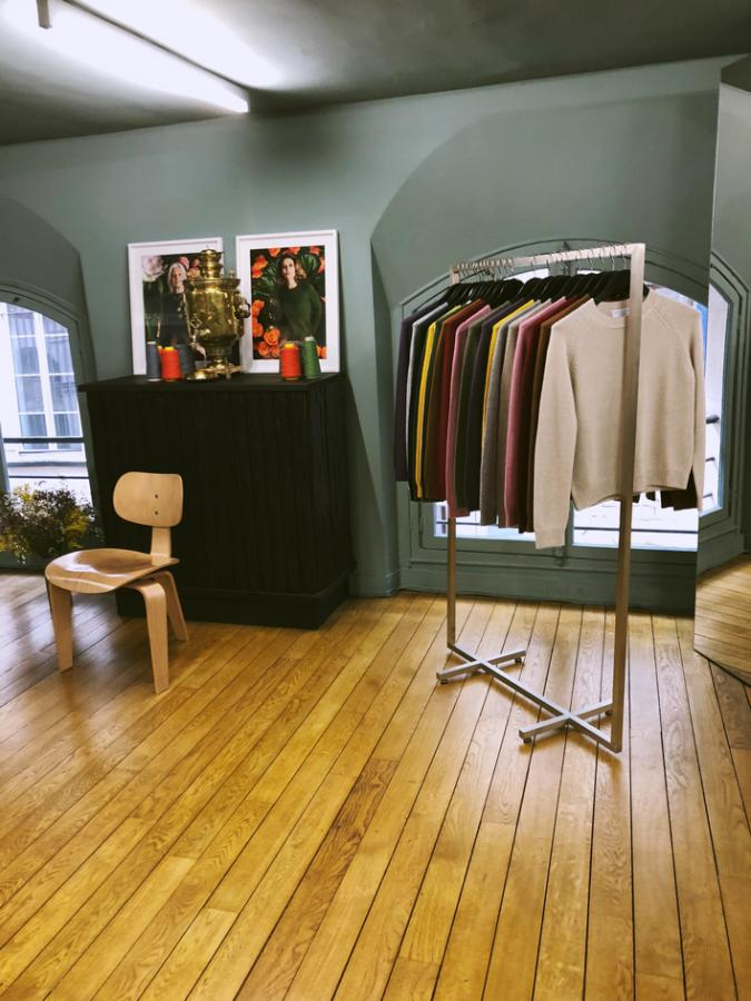 Alexandra Golovanoff: Cashmere sweaters hang on a studio rail