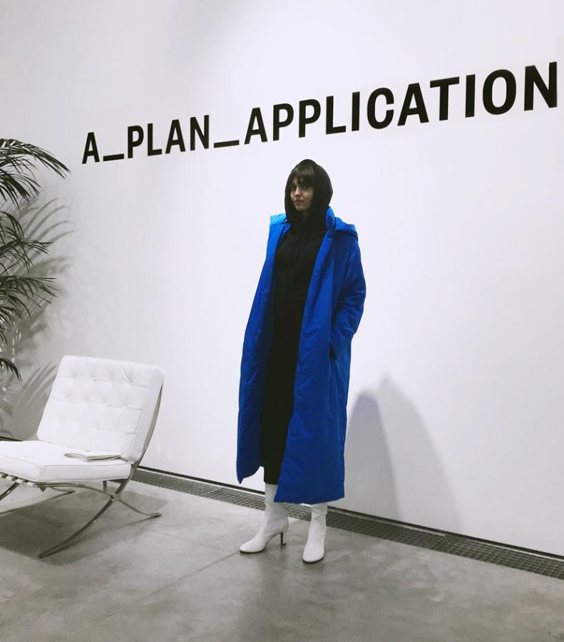 A_ PLAN_APPLICATION: Model wears a long blue coat and white sock heels