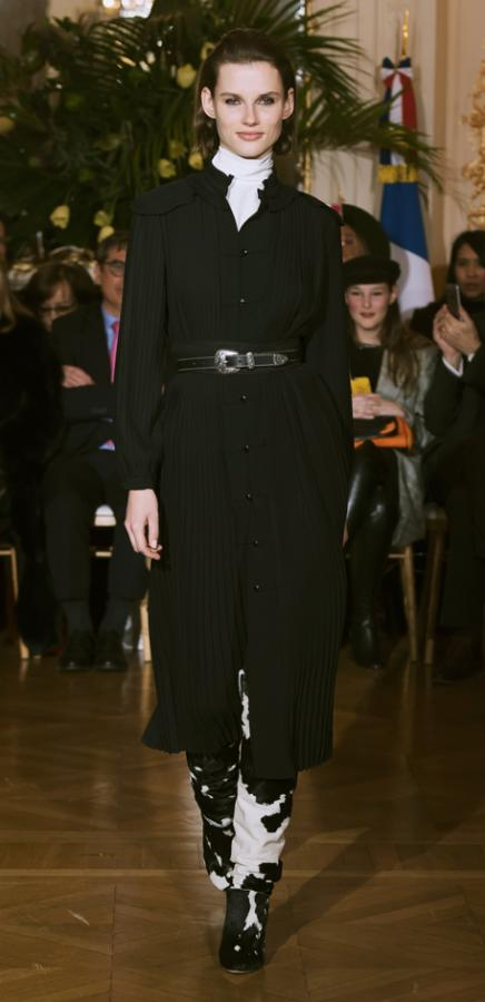 Vanessa Seward A/W 2018: Model wears a black dress and cowskin boots