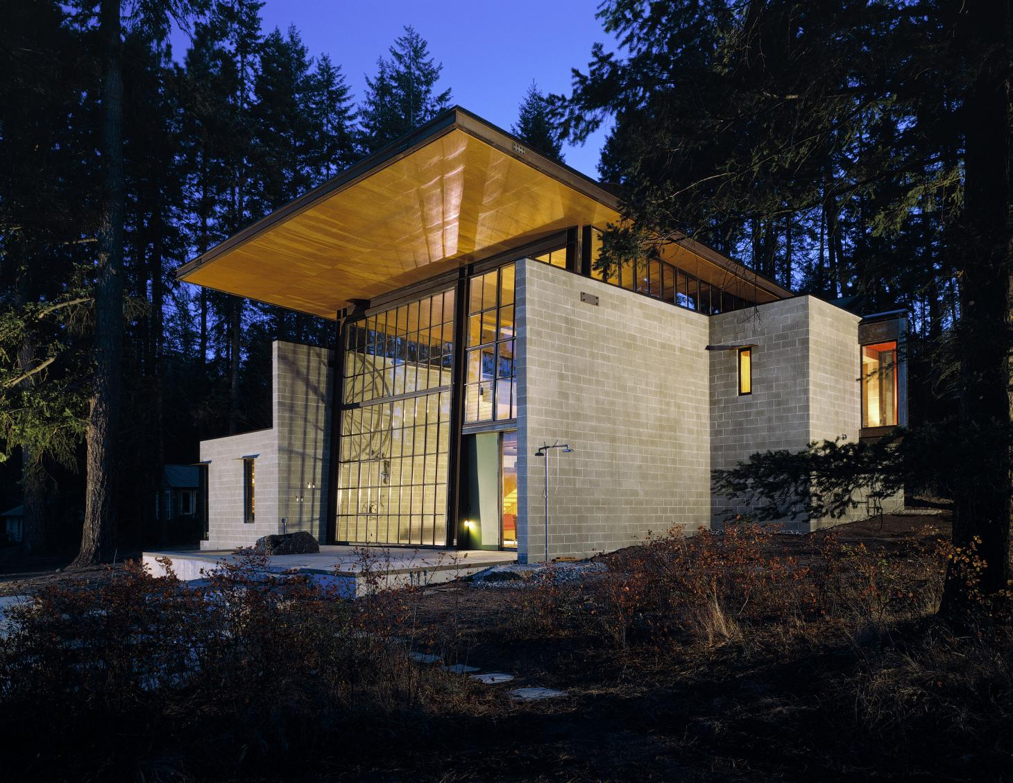 Chicken Point Cabin's large window wall at night