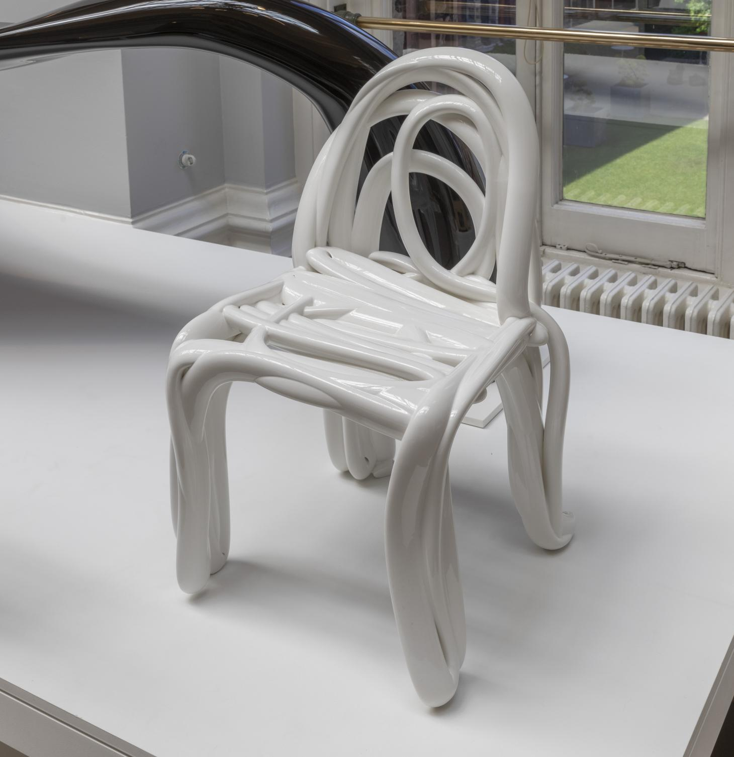 A white chair by front made with a process whose result resembles a wriggly hand sketch