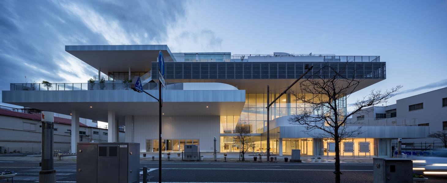 Sukagawa Community Center as seen at dusk with its clean, geometric forms and sculptural appearance