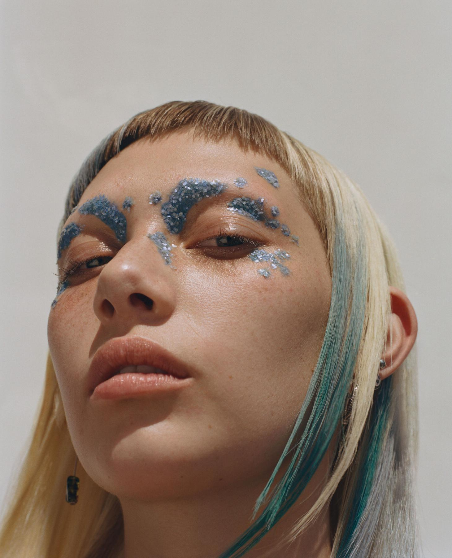 woman wearing submission biodegradable glitter in blue