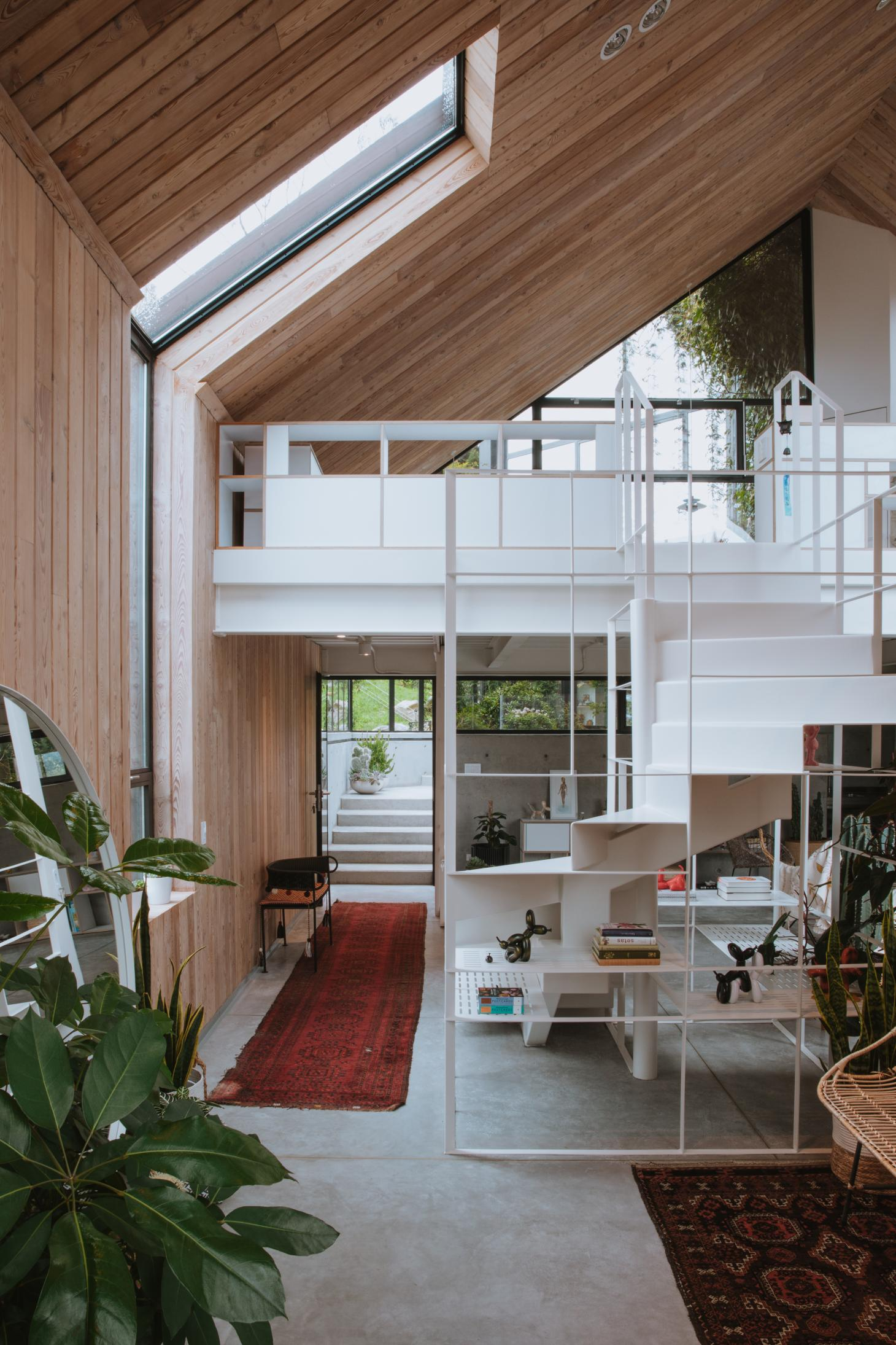 Colombian Casa SKL's visible roof pitch from the inside, clad in timber