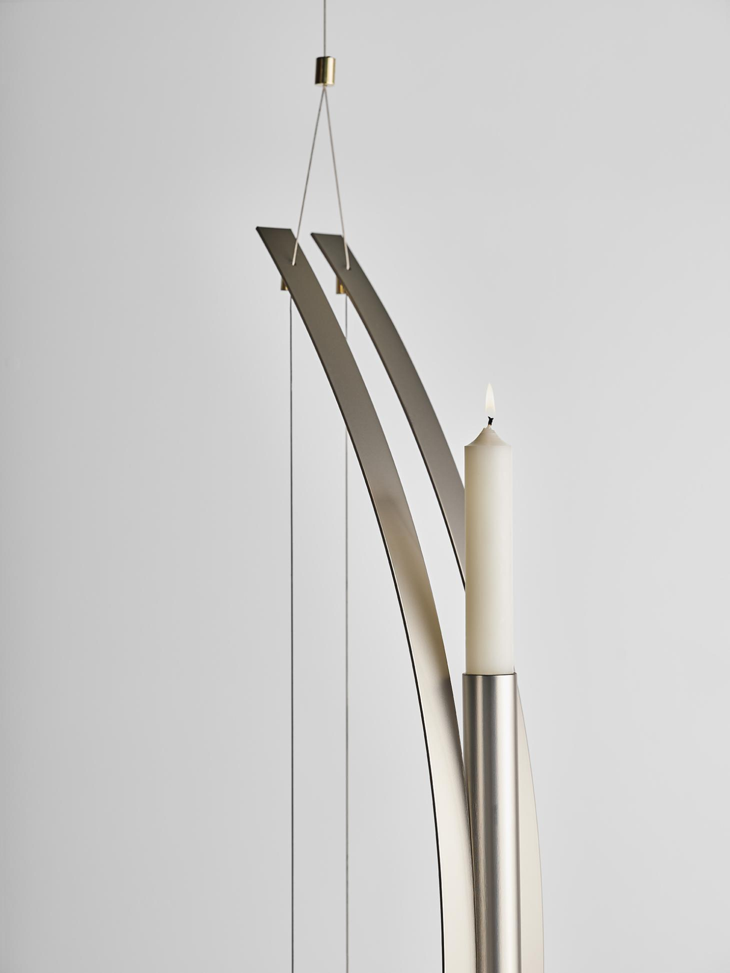 Hanging candleholder in brass by Federica Biasi with white candle