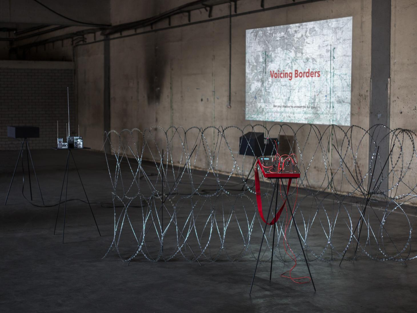 Installation Voicing Borders by Irakli Sabekia, featuring razor wire in a bare room