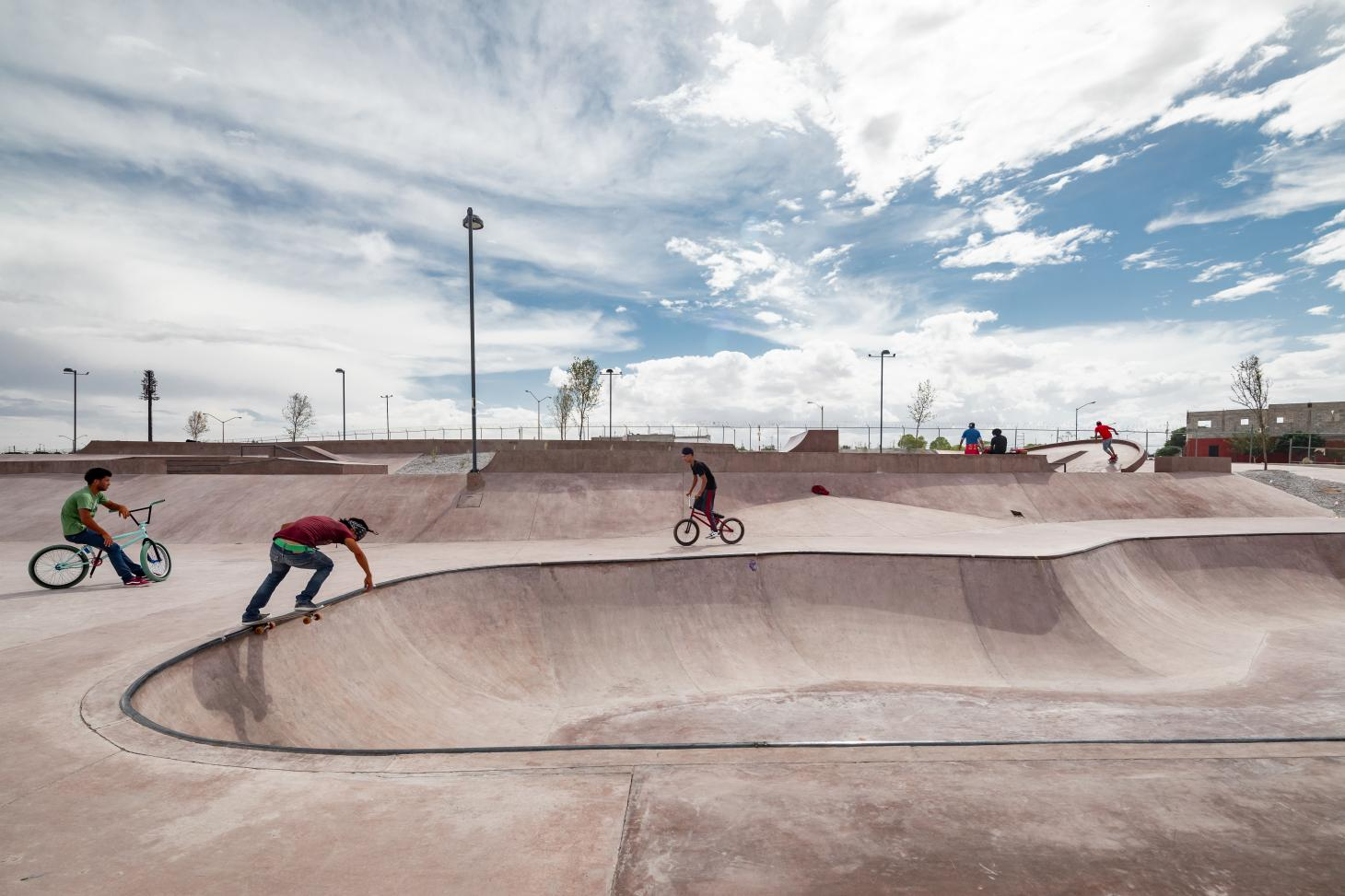 pink concrete and skaters at skatepark