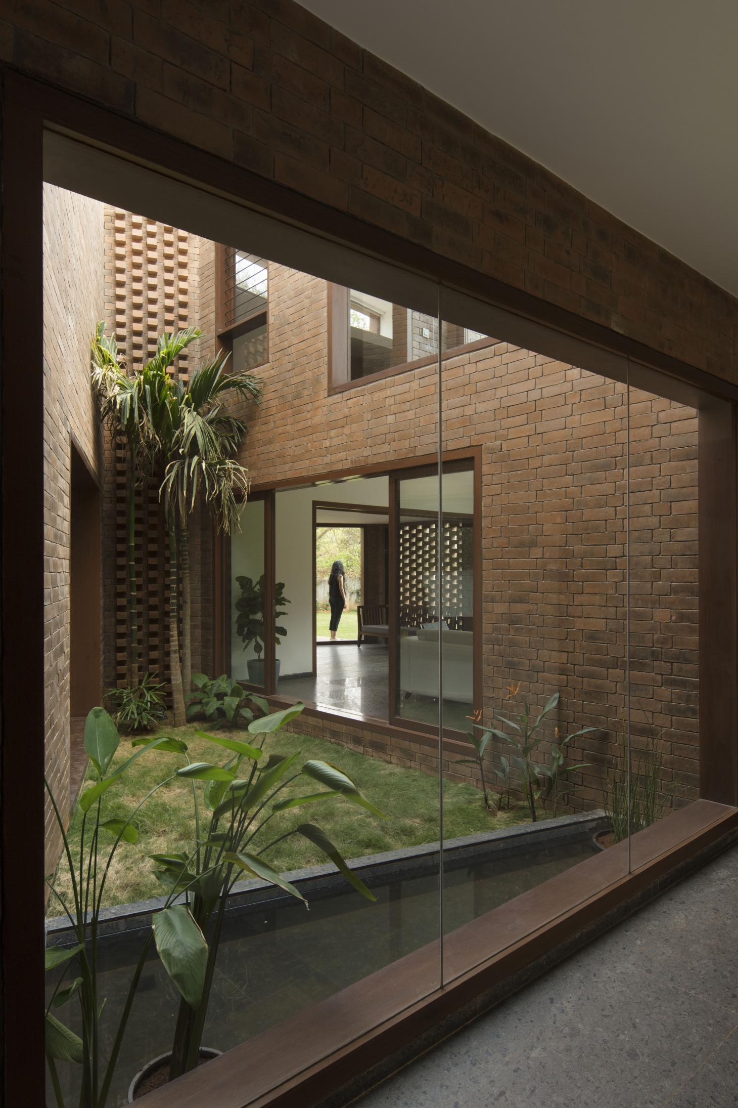 Brick House features green courtyards