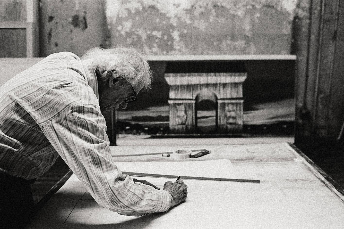 Christo in his studio working on a preparatory drawing for L'Arc de Triomphe, Wrapped,New York City, 2020