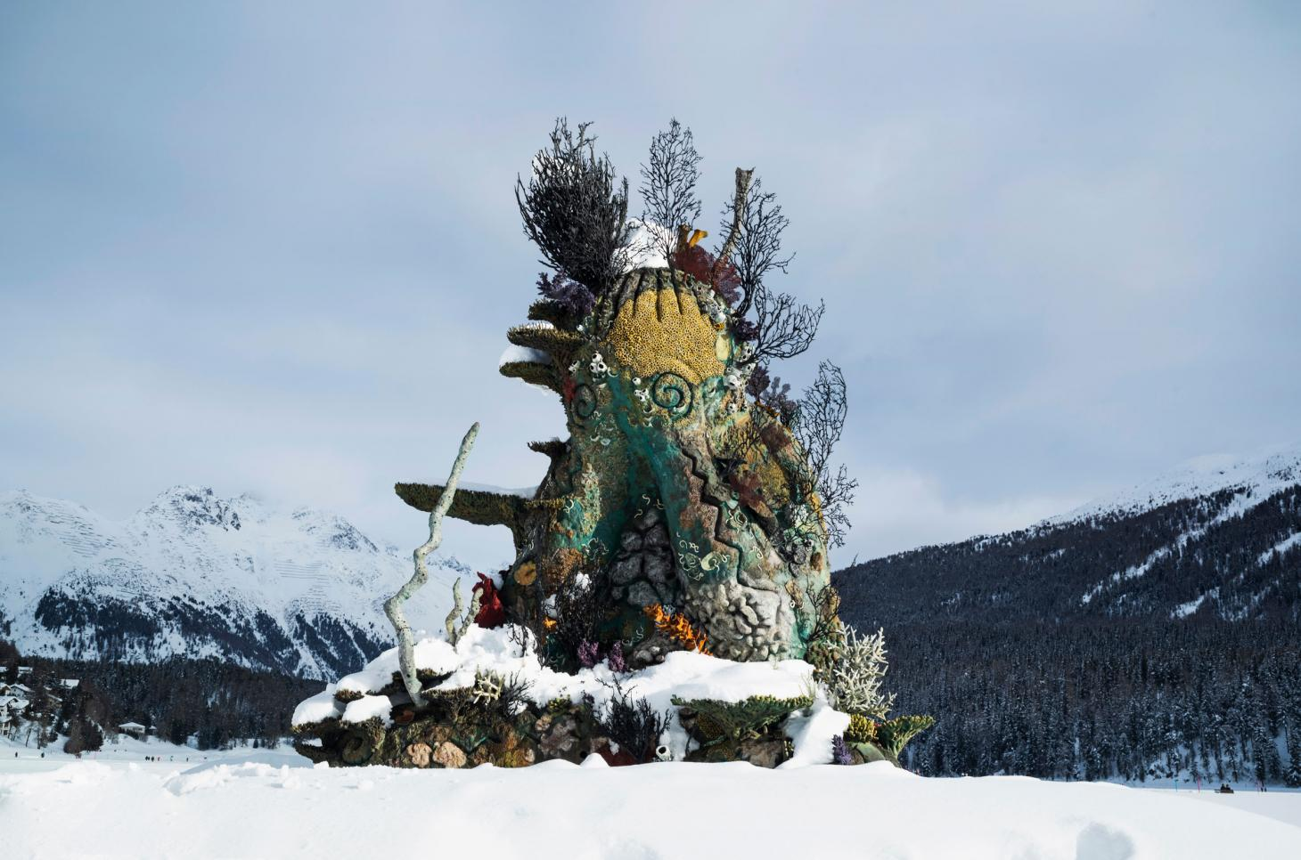 Photograph of Damien Hirst's The Monk sculpture being installed on Lake St. Moritz